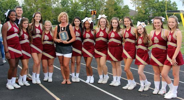 Suzanne Denecke with cheerleaders